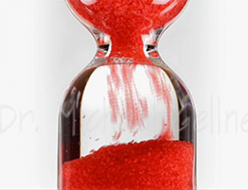Hourglass with red balls