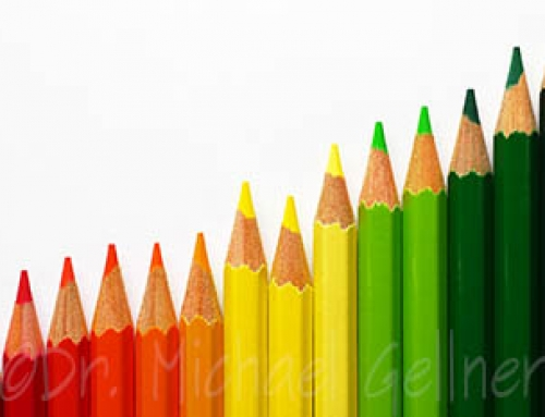 Coloured Crayons with white paper background